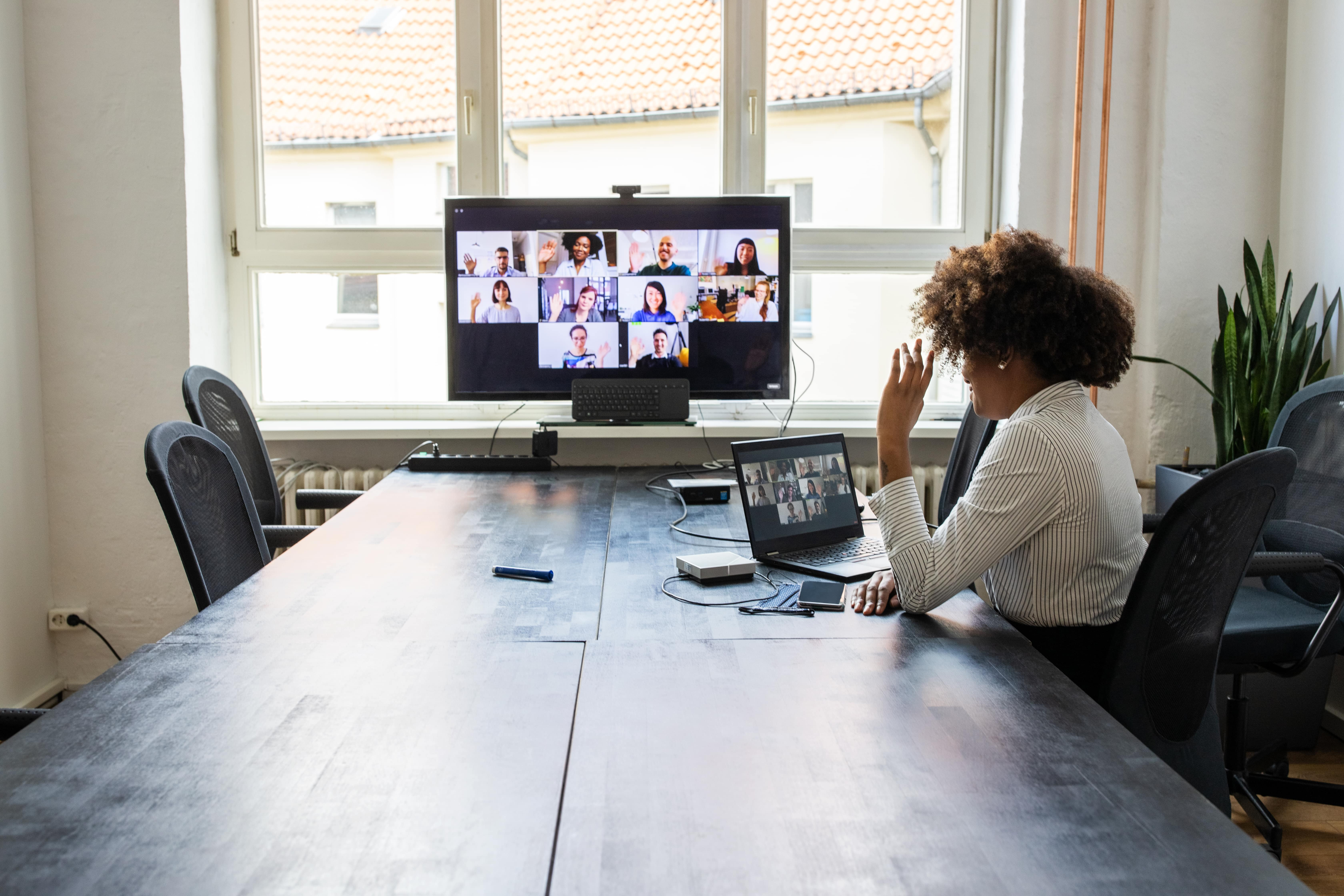 Woman in an online meeting with her team