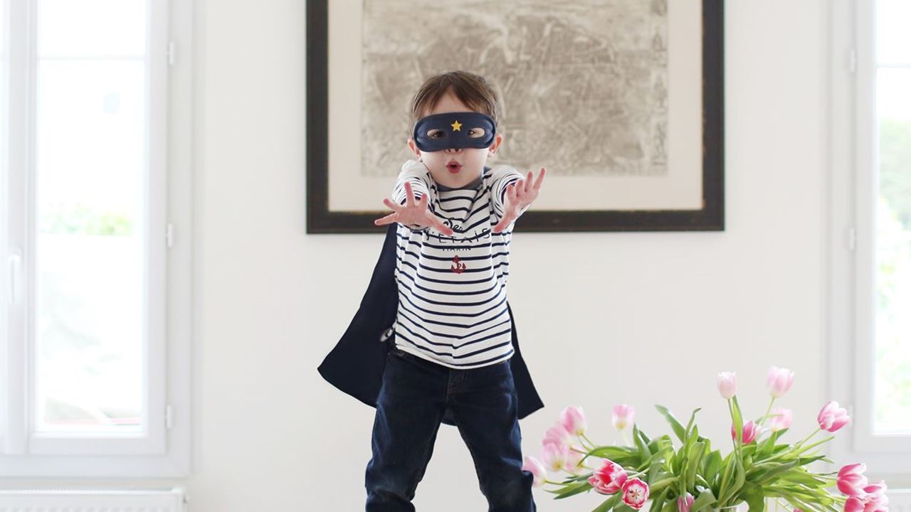 Little boy dress up as superhero