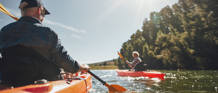 mature-couple-canoe-700x300